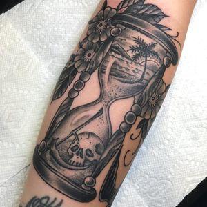 Tattoo by Beau Brady #BeauBrady #hourglasstattoos #hourglass #time #glass #blackandgrey #skull #landscape #beach #sun #palmtree #sand #flowers #floral