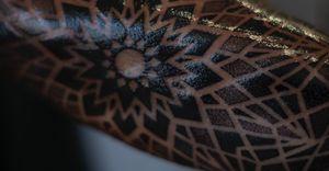 Close up glossy version of this negative space dotwork mandala.
