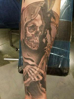 Black and grey grim reaper forearm piece.