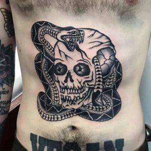 Tattoo by Gusak #Gusak #skulltattoo #skull #death #bones #snake #serpent #reptile #traditional #blackandgrey