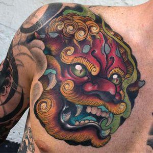 Tattoo by Corey Norris #CoreyNorris #fooddogtattoo #shishi #foodog #lion #guardian #folklore #protector #color #newschool