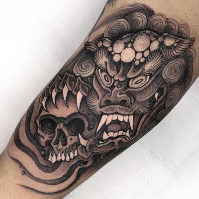 Tattoo by Gabriele Cardosi #GabrieleCardosi #fooddogtattoo #shishi #foodog #lion #guardian #folklore #protector #blackandgrey #skull #fire #darkart #illustrative