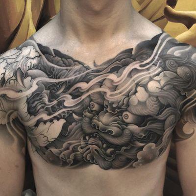 Tattoo by Zhanshan Tattoo #Zhanshan #fooddogtattoo #shishi #foodog #lion #guardian #folklore #protector #blackandgrey #flowers #peony #floral #smoke