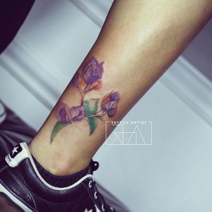 """She can always hear what you say."" #flowertattoo #worldfamousink #tattoooftheday #momlove #flowers #coloredtattoo #joaantountattoos #lebanesetattooartist #tattooink #lebanon"