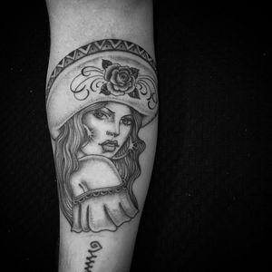 Tattoo by Chuco Moreno #ChucoMoreno #blackandPOCtattoos #POCtattoos #lady #ladyhead #sombrero #rose #flower #floral #leaves #oldschool #blackandgrey