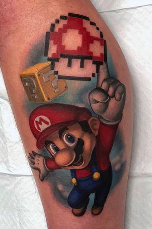 Mario reaching for a 1up mushroom