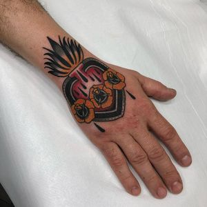 Tattoo by Rodrigo Kalaka #RodrigoKalaka #religioustattoo #Christian #Catholic #religious #sacredheart #heart #fire #blood #love #rose #traditional #color #handtattoo