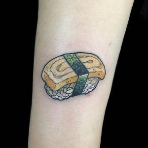 Tattoo by Wendy Pham #WendyPham #sushitattoo #sushi #foodtattoo #food #Japanese #rice #egg #omelet #TamagoNigiri #seaweed #cute #small