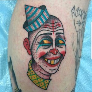 Tattoo by Ozzy Ostby #ozzyostby #besttattoos #traditional #color #clown #creepy #circus #strange #goldtooth #portrait #pattern