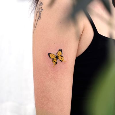 Tattoo by Siyeon #Siyeon #butterflytattoo #butterfly #insect #nature #wings #fly #pattern #watercolor #realistic #realism #color #tiny #small #minimal #cute #yellow