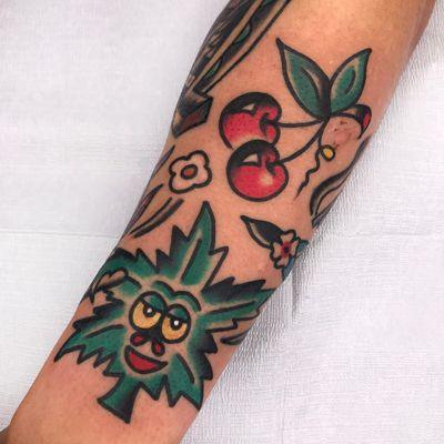 Tattoo by Needles Tattooing #Needlestattooing #cherrytattoos #cherrytattoo #cherry #fruit #fruittattoo #foodtattoo #food #cute #color #traditional #weed #weedlead #maryjane #420 #flowers