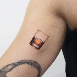 Tattoo by Youyeon #Youyeon #Seoultattoos #Seoul #KoreanArtist #color #realism #realistic #hyperrealism #glass #drink #alcohol #whiskey #liquid