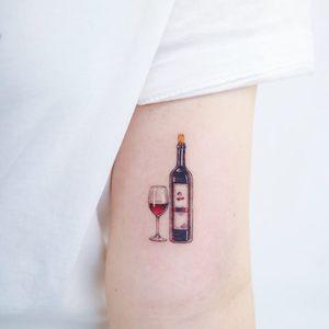 Tattoo by Heemee #Heemee #Seoultattoos #Seoul #KoreanArtist #color #realism #realistic #hyperrealism #glass #bottle #wine #cherry #cherrywine #alcohol #drink #wineglass #wino