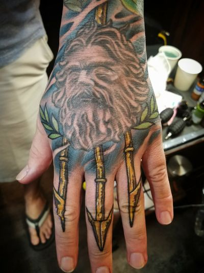 Got a trident added to King Neptune. Tattoo done by Jun and Kaori Tattoo in Okinawa Japan, Chatan. #handtattoo #hands #neptune #trident #posideon