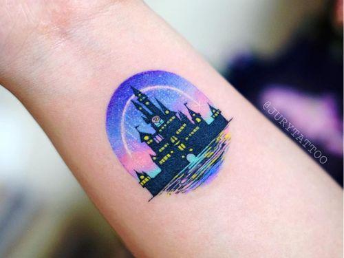 Tattoo by Jury Tattoo #JuryTattoo #Disneytattoo #Disney #cartoon #animation #castle #color #watercolor #Disneycastle #moon #sparkles #sky #night #lights