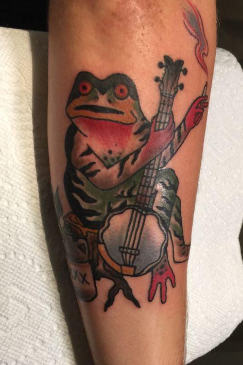 Banjo playing moonshine drinking smoking frog