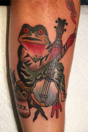 Banjo playing moonshie drinking smoking prty frog.