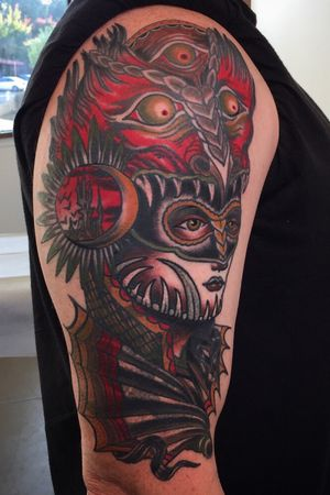 Cover up of a bio hazard symbol with a lady amd demon helmet.