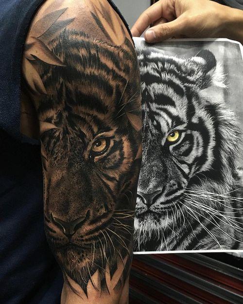 Tattoo by Fred Thomas #fredytattoos #exotictattoomurica #realism #surreal #tiger #blackwork