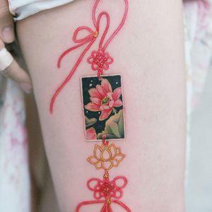 lotus flower norigae embroidered along the side of her leg *Norigae= Korean traditional ornaments. #flowertattoo #floraltattoo #Korea #KoreanArtist #tattooistsion #colortattoo #flower #flowers #oriental #norigaetattoo