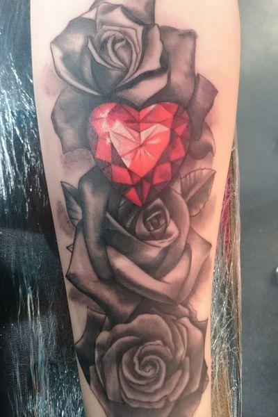 Feminine forearm composition with heart-shaped jewel #ruby #roses #feminine #blackandgrey #jewel #glasgow #birthstone