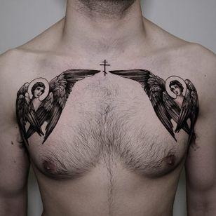 Tattoo by Andrew Borisyuk #AndrewBorisyuk #illustrative #angels #wings #feathers #cross #halo #blackandgrey #chestpiece