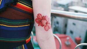 Two hibiscus flowers on her arm. by SION (@tattooistsion) #flowertattoo #floraltattoo #Korea #KoreanArtist #tattooistsion #colortattoo #flower #flowers #oriental