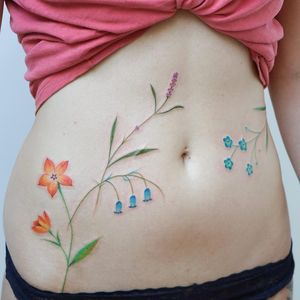 Tattoo by Jess Chen #JessChen #besttattoos #flowers #floral #leaves #nature #waterclor #realism #realistic