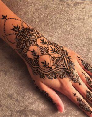 Instagram: @raeesa.azx working inspired by leeds_mehndi love this design #inspiration #black #henna #tattoo #design #floral #mehndi #jagua #art #work #ink