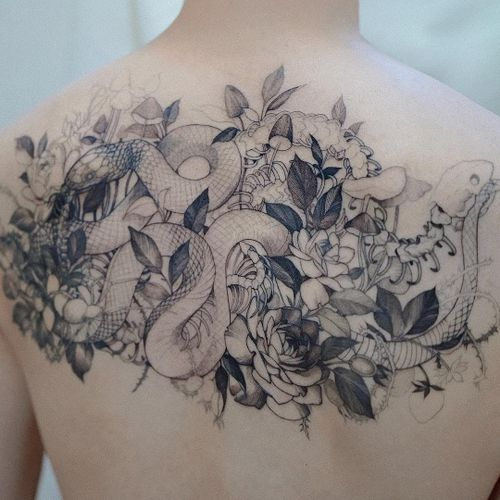 Tattoo by Zihwa #Zihwa #detailedtattoos #detailed #intricate #snake #reptile #flowers #floral #skeleton #leaves #nature