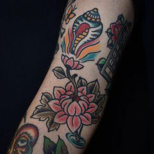 Tattoo by Tony Trustworthy #TonyTrustworthy #Buddhisttattoos #Buddhist #Buddha #meditation #mindfulness #peace #love #compassion #conch #shell #seashell #lotus #flower #floral #stairway #color #traditional