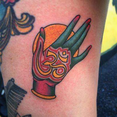 Tattoo by Shaun Topper #ShaunTopper #Buddhisttattoos #Buddhist #Buddha #meditation #mindfulness #peace #love #compassion #mudra #om #symbol #hand #color