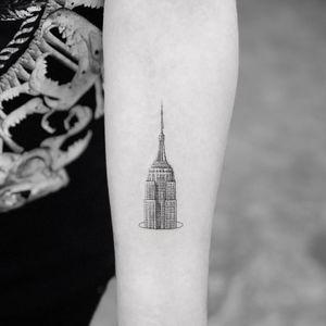 Tattoo by Mr K #MrK #architecturetattoos #architecture #building #house #detailed #EmpireStateBuilding #tiny #small #illustrative