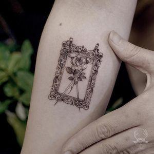 Tattoo by Zihwa #Zihwa #tinytattoo #tiny #smalltattoo #small #illustrative #swords #frame #filigree #flower #rose #leaves #nature #fineline