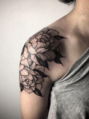 Floral dotwork peony shoulder tattoo.
