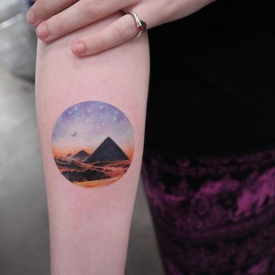 Tattoo by Eva Krbdk #EvaKrbdk #perfectlyplacedtattoos #placement #realism #realistic #hyperrealism #watercolor #pyramid #egypt #moon #stars #landscape #desert