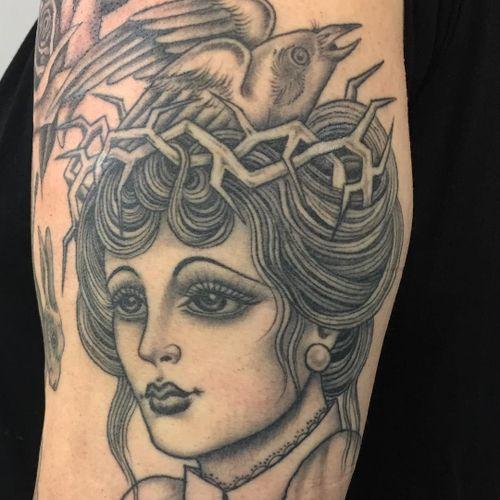 Tattoo by Sarah Schor #SarahSchor #blackandgrey #oldschool #crownofthorns #tears #ladyhead #lady #portrait #thorns #bird #feathers