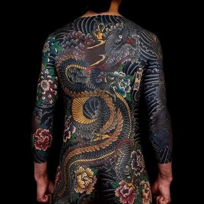 Tattoo by Horitoshi #Horitoshi #dragontattoos #dragon #mythicalcreature #legend #folklore #color #irezumi #Japanese #peony #smoke #flowers #floral #chrysanthemum