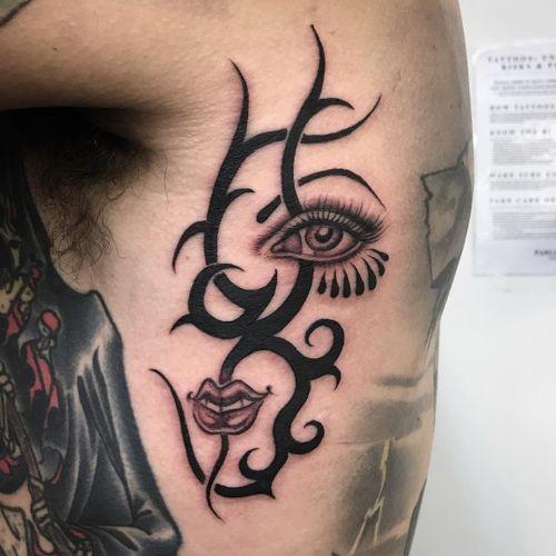 Tattoo by Sarah Schor #SarahSchor #blackandgrey #oldschool #tribal #eye #lips #tears #eyelashes