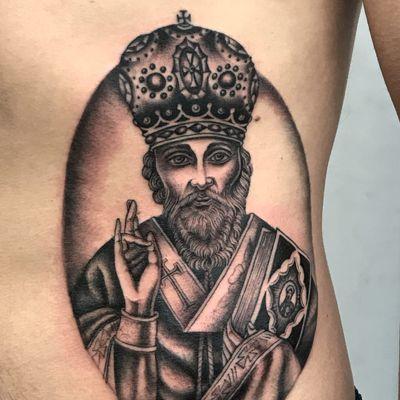 Tattoo by Sarah Schor #SarahSchor #blackandgrey #oldschool #StNick #crown #cross #religious #peace #bible #portrait