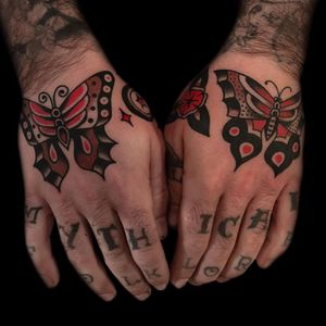 Tattoo by Austin Maples #austinemaples #handtattoo #hand #jobstopper #color #traditional #butterfly #flower #floral #wings #star