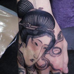 Tattoo by Haku Tattoo #Haku #HakuTattoo #handtattoo #hand #jobstopper #blackandgrey #Japanese #illustrative #geisha #portrait #ladyhead #snake #reptile #animal