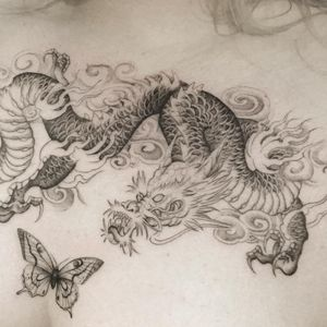 Tattoo by the.hanged #thehanged #besttattoos #Best #linework #illustrative #details #dragon #fire #cloud #Japanese #butterfly