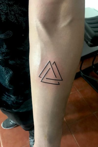#triangle #triangletatoo #geometric #triangles #minimalist Triangle Tattoo Meaning Other than the holy trinity, the triangle tattoo has been used to represent a variety of other trinities. Some of the most popular examples include: – Past, present and future – Thought, feeling and emotion – Mother, maiden and crone – Mind, body and spirit – Creation, preservation and destruction – Waxing moon, waning moon, full moon – Mother, father and child