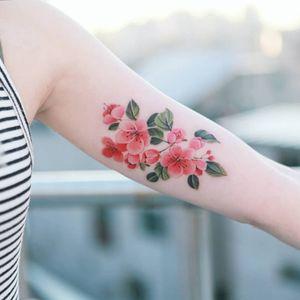 Flowers on her arm. #tattoo #Korea #tattooart #koreatattoo #koreatattooist #flowertattoo #illustration #birthflowertattoo #tattooistartmag #hongdae #flowers #coloredtattoo #watercolortattoo #hongdaetattoo #norigae #tattooistsion