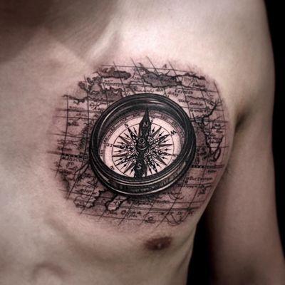 Tattoo by Kiljun #Kiljun #blackandgreyrealismtattoos #blackandgreyrealism #blackandgrey #realism #hyperrealism #realistic #compass #map #travel