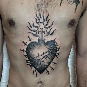 Tattoo by Justin Olivier #justinolivier #torsotattoos #torso #blackandgrey #sacredheart #heart #fire #love #catholic #religious #thorns #swords #cross