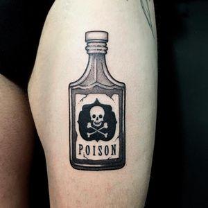 Tattoo by Mr Lauder #MrLauder #HalloweenTattoos #Halloween #Samhain #spooky #trickortreat #AddamsFamily #bottle #poison #skullandcrossbones #skull #death