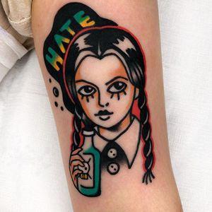 Tattoo by Red Lip Tattoo #RedLipTattoo #HalloweenTattoos #Halloween #Samhain #spooky #trickortreat #color #traditional #AddamsFamily #wednesdayaddams #bottle #skullandcrossbones #death #hate #portrait