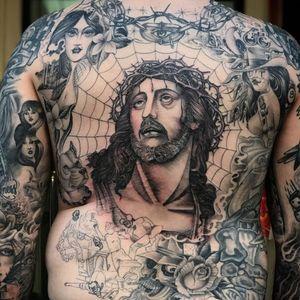 Tattoo by Big Steve #BigSteve #Chicanotattoos #Chicano #Chicanostyle #Chicanx #Jesus #gun #payasa #rose #skull #cholo #barbedwire #spiderweb #pitbull #blackandgrey #crownofthorns